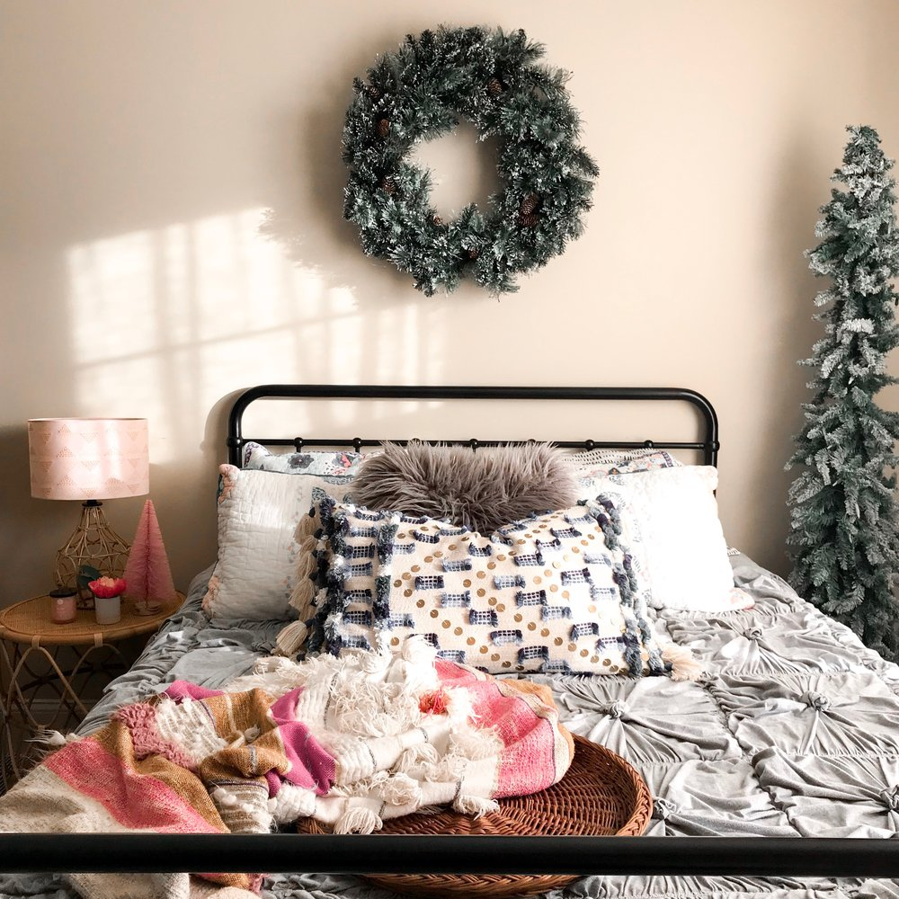 This is our guest bedroom! and it's been so sweet having guest enjoy teeny decorations in their room this season.