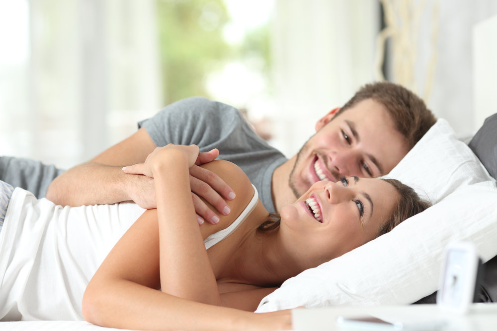AdobeStock_99203779 MAN WOMAN COMFY IN BED.jpeg