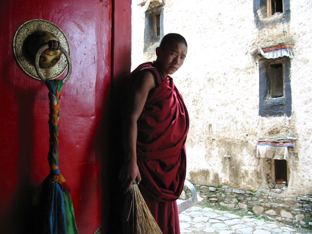 Monk with Broom