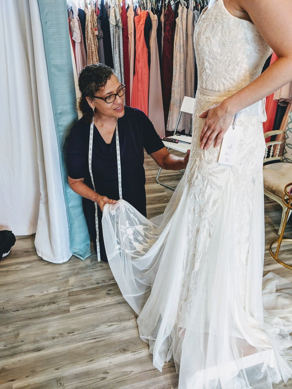 Wanda Bannerman - Ms Wanda is our loving and incredibly skillful seamstress! With a fine arts background and over 30 years of bridal dress experience, she brings a detailed eye to each dress with a mindfulness for every bride.
