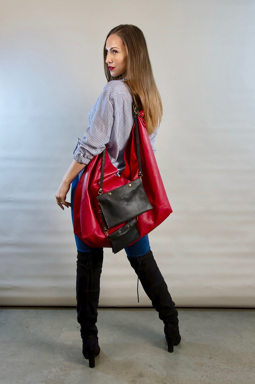 """- LARGE RED LEATHER BAG W/ SMALL AND LARGE 3 POCKET POUCH ATTACHED W/ TWO 15'"""" KEYSTRAPS AND TWO 7"""" KEYSTRAPS"""