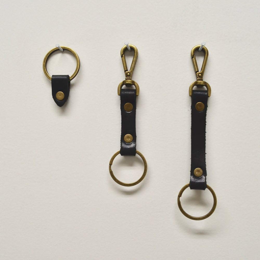 """- LEATHER TAB KEYRING IN BLACK, 5"""" LEATHER CLIP KEYRING IN BLACK & 61/4"""" CLIP KEYRING IN BLACK"""