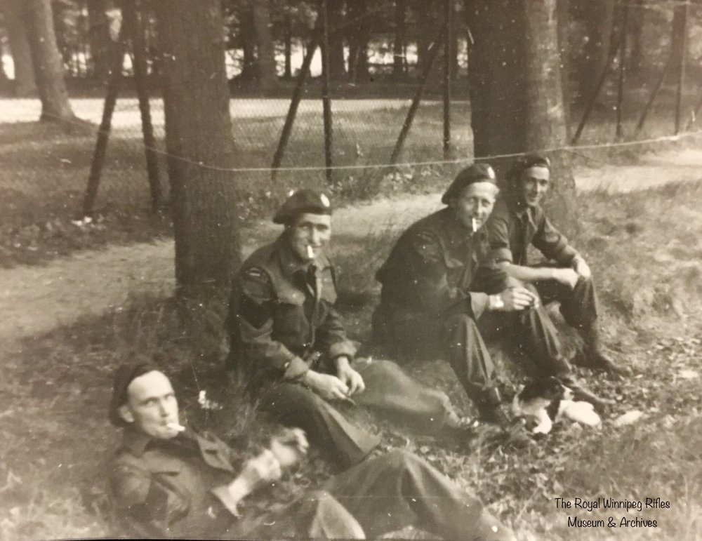 Royal Winnipeg Rifles taking a break somewhere in Holland, 1944 or 1945.
