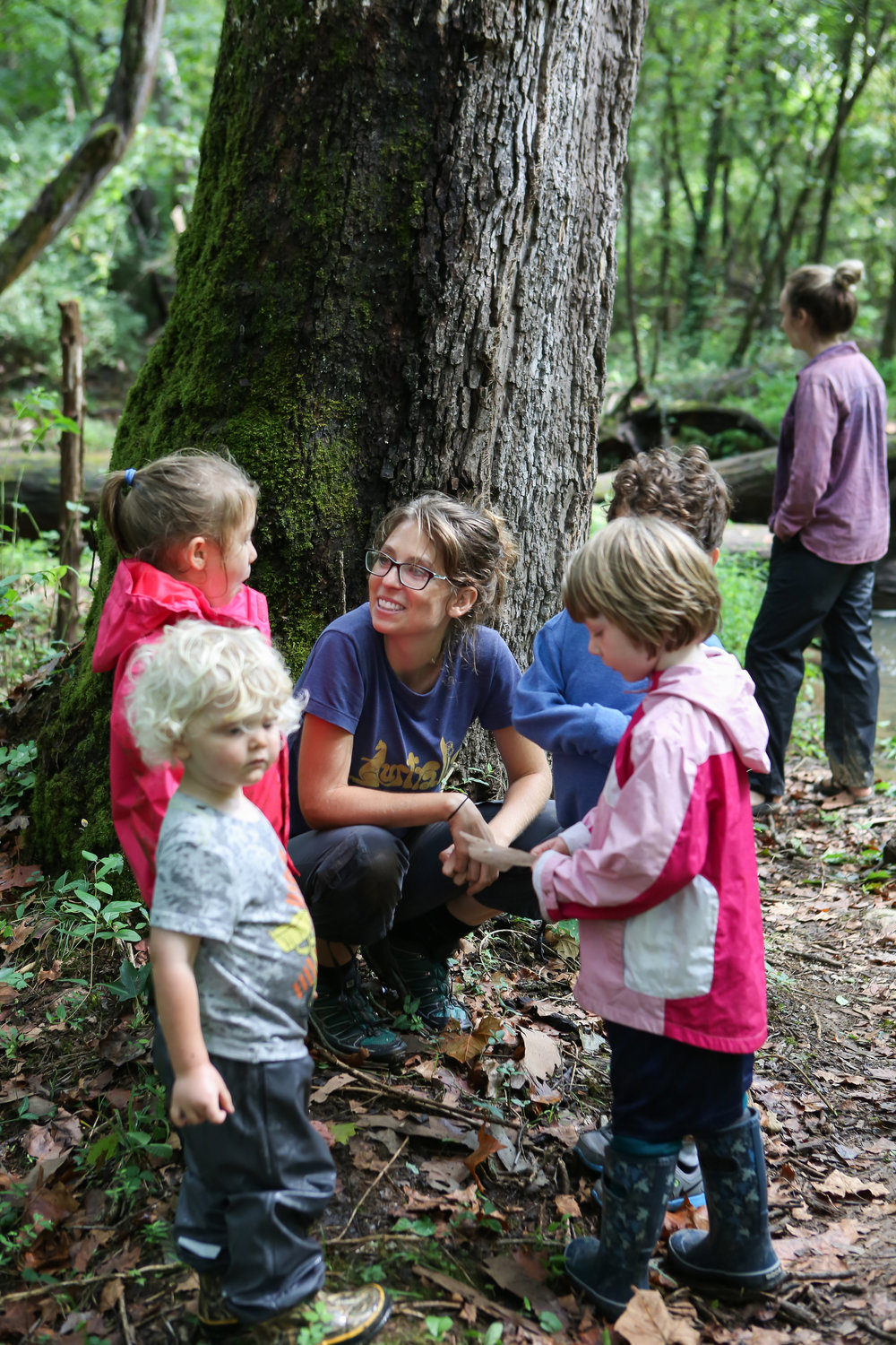Our forest school director, Sara Otis, takes a moment to deeply explore something the kids have already started to explore on their own initiative. This teaches them the value of discovery.