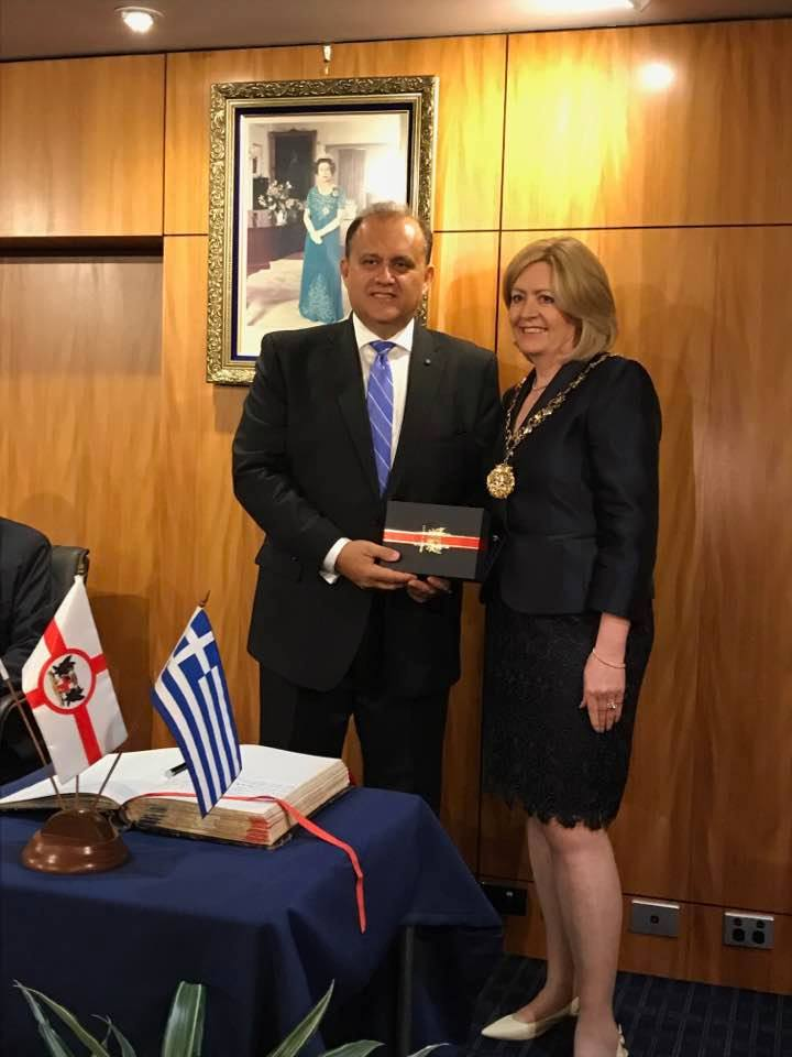 The Honorable Lord Mayor of Perth, Lisa-M. Scaffidi, presenting Larigakis with a commemorative gift