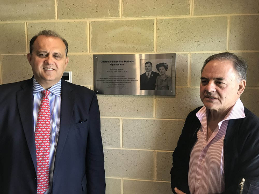 With Con Berbatis in front of a commemorative plaque of his parents of which the Gym of the St. Andrew's Grammar school is named after