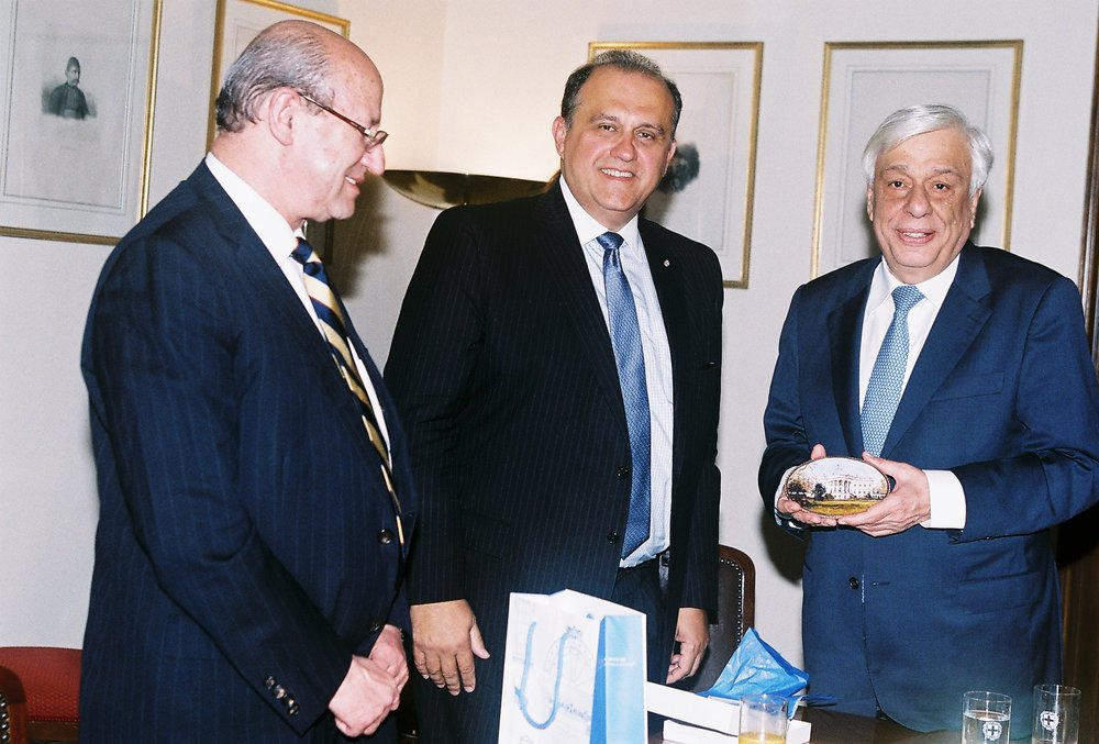 AHI Foundation President Constantine Galanis and AHI President Nick Larigakis presenting President Pavlopoulos with a gift