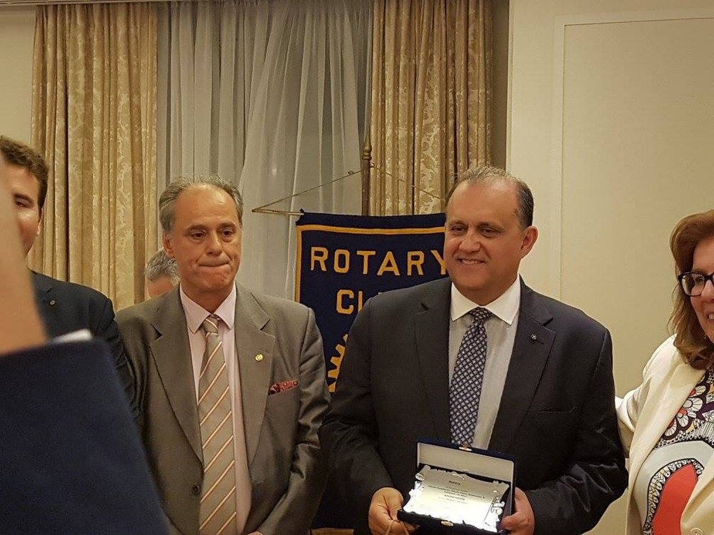 Nick Larigakis receiving a commemorative plaque from the Rotary Clubs in Athens