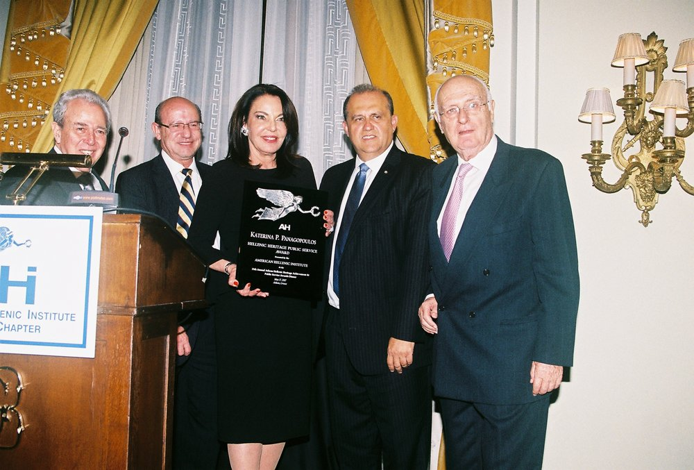 George Economou, Constantine Galanis, Nick Larigakis, Ilias Malevitis present Katerina P. Panagopoulos with the Hellenic Heritage Public Service Award