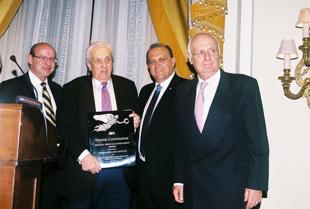 Constantine Galanis, Nick Larigakis, Ilias Malevitis present Dimitri Contominas with the Hellenic Heritage Achievement Award