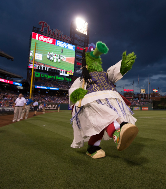 The Phillie Phanatic marches in to dance with the Pan-Macedonian Dance Group. (photo credit: Philadelphia Phillies)