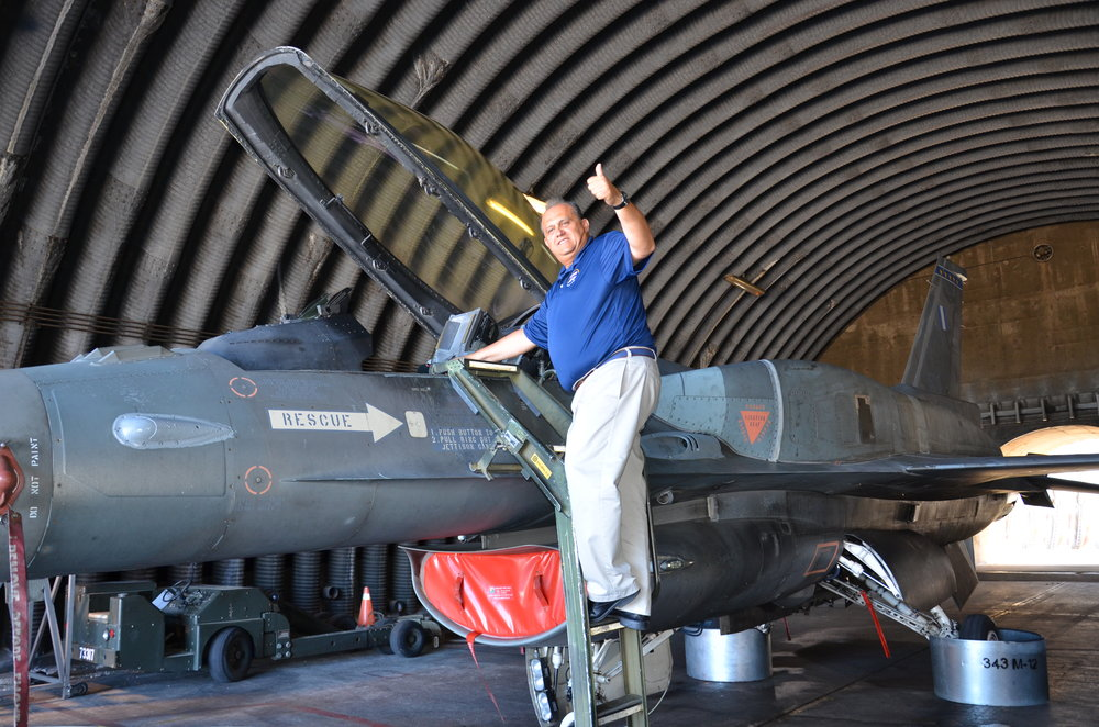 Nick Larigakis with a Hellenic Air Force F-16 fighter jet.