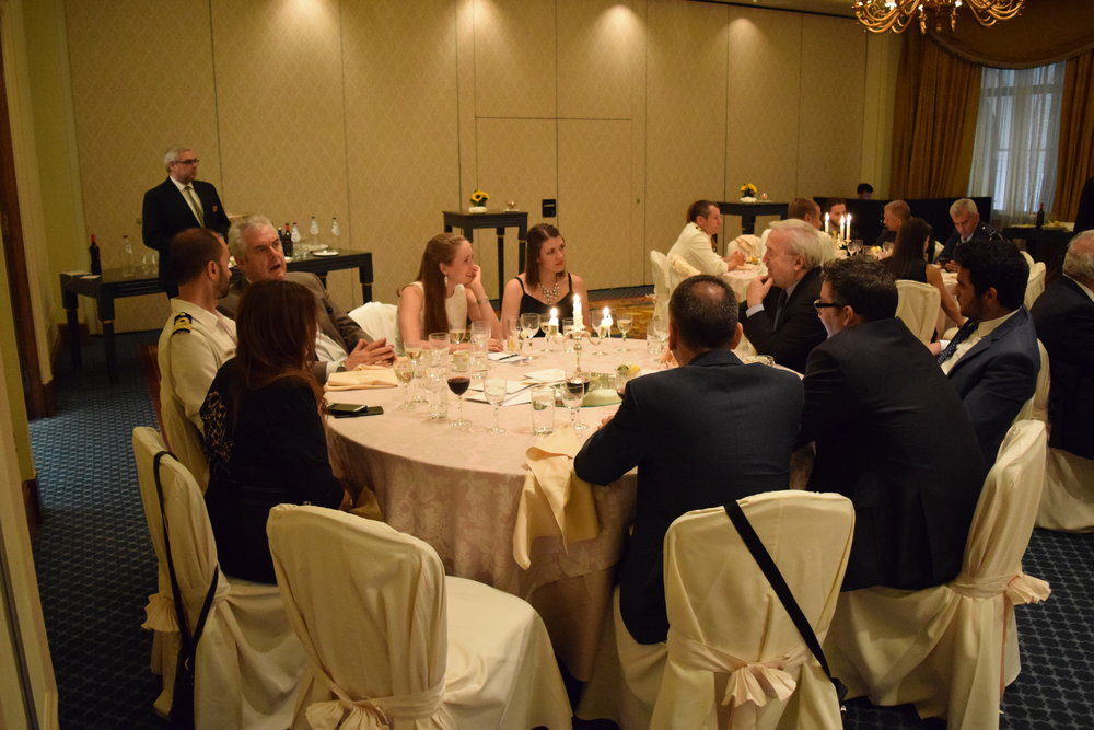 Students, supporters, and Greek Officials who all made the program possible come together at the Farewell Dinner to hear the firsthand accounts of the students.