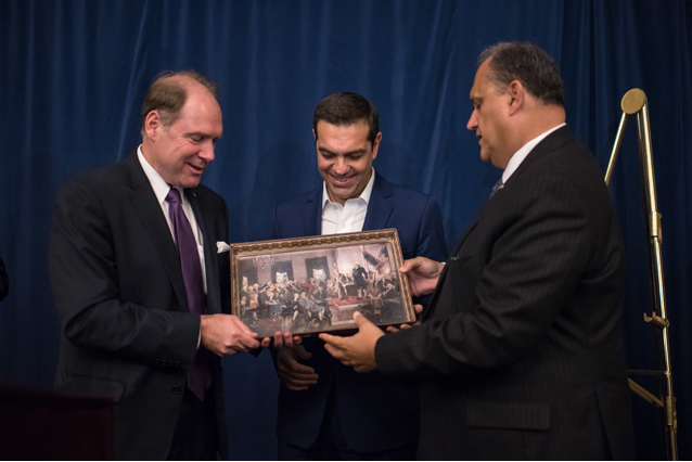 AHI President Larigakis and AHEPA Supreme President Hollister present Prime Minister Tsipras with a painting of the signing of the Declaration of Independence.