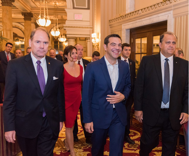AHI President Larigakis and AHEPA Supreme President Hollister escort Prime Minister Tsipras and his partner, Betty Batziana, into the dining room.