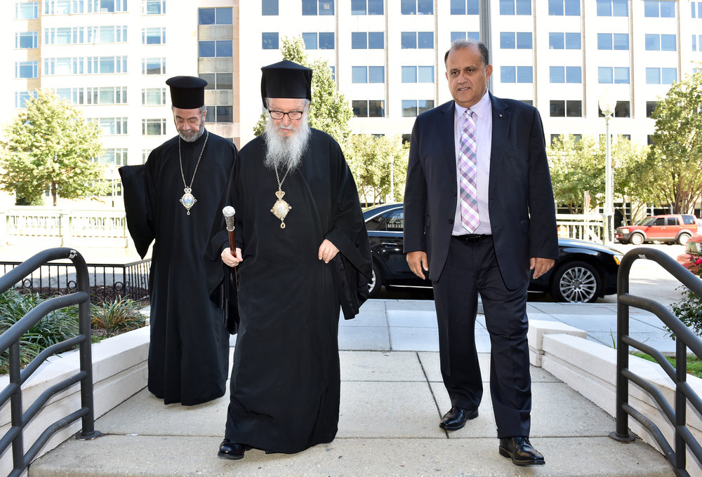 His Eminence Archbishop Demetrios, Geron of America; AHI President Nick Larigakis; and Bishop Sevastianos of Zela entering AHI headquarters, Hellenic House.