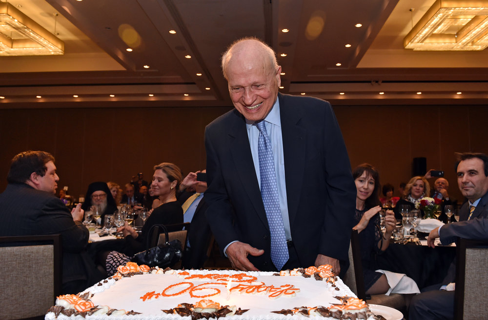 Eugene Rossides celebrates his ninetieth birthday with a surprise cake.