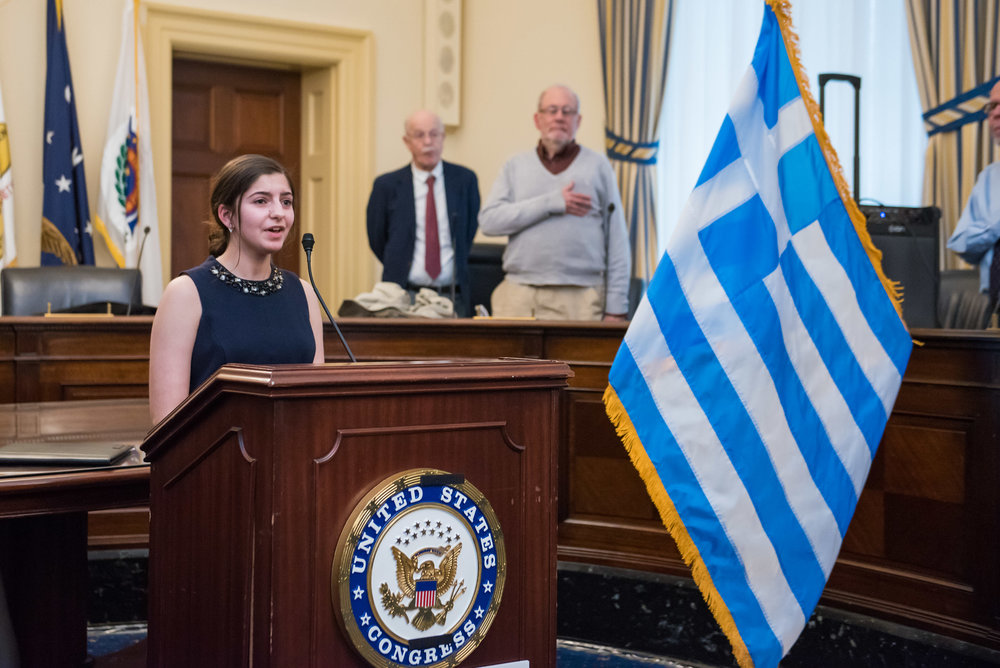 Maria Karageorge sings the American and Greek National Anthems.