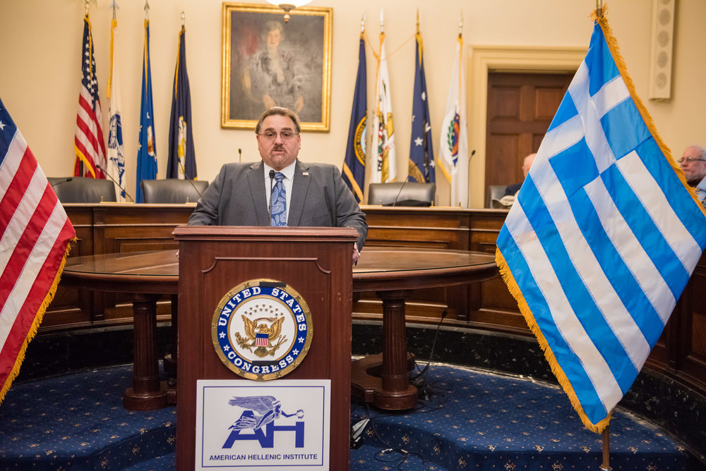 Basil Mossaidis, Executive Director of AHEPA, offers remarks.