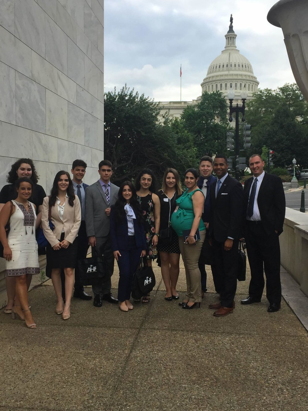AHI student trip participants standing outside U.S. Capitol Building with Shayne Woods, legislative assistant for Rep. Gus Bilirakis (R-FL) & Christina Parisi, legislative director for Rep. Carolyn Maloney (D-NY), Hellenic Caucus co-chairs.