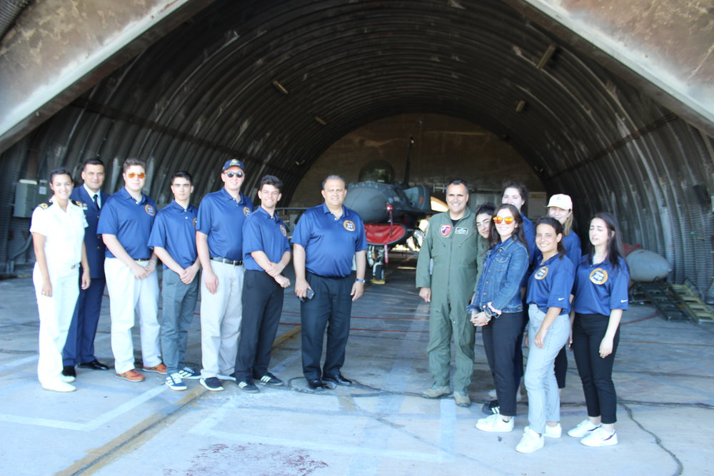Students next to an F-16 aircraft at the 115th Combat Wing.