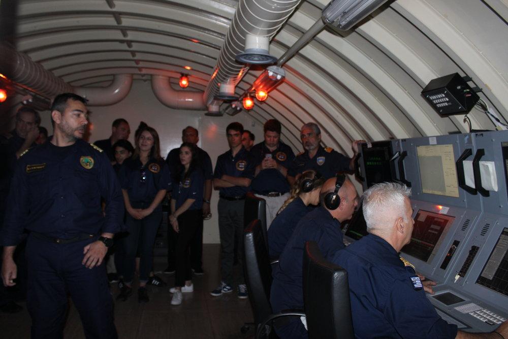 Guided tour of a submarine simulator.