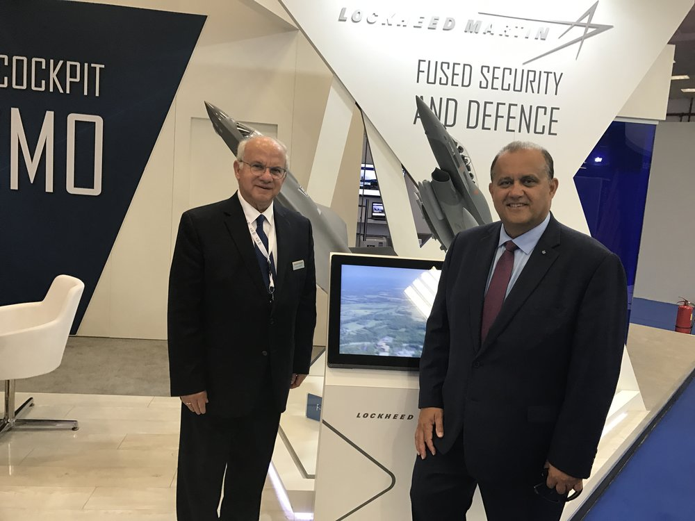 Dennys Plessas, Vice President of Business Development Initiatives Europe, Middle East, & Africa, Lockheed Martin Aeronautics and Nick Larigakis in front of the Lockheed Martin exhibit in the U.S. pavilion.