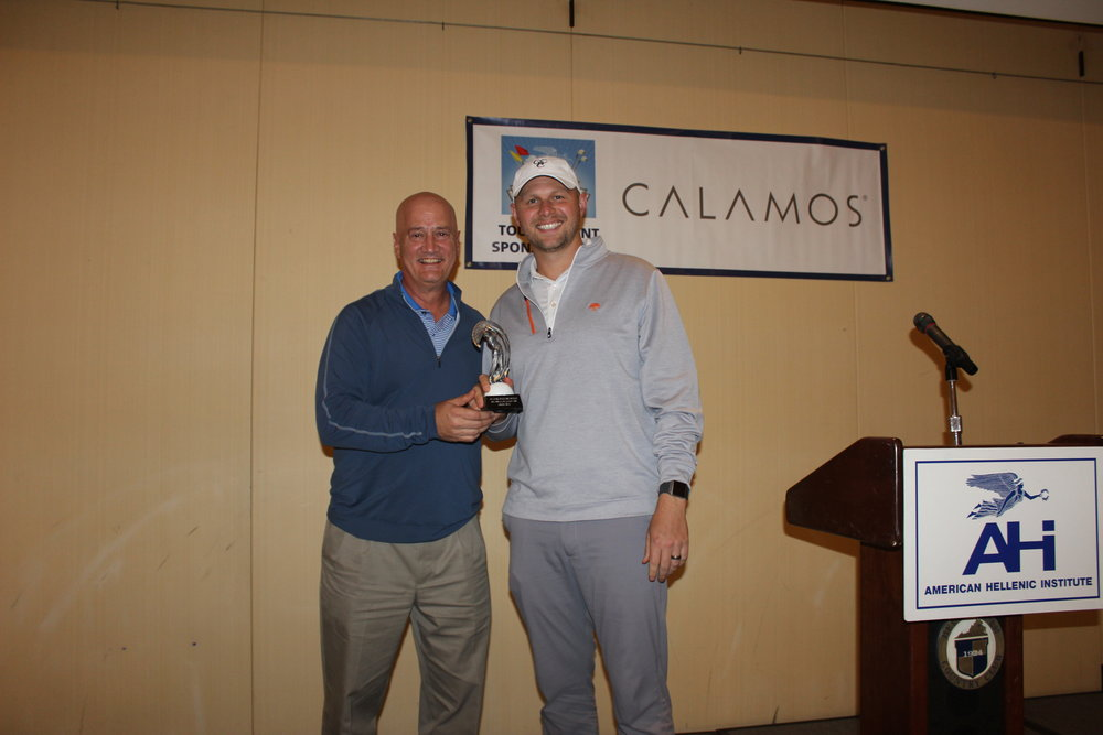 James Tomaseski earns the Longest Drive trophy.