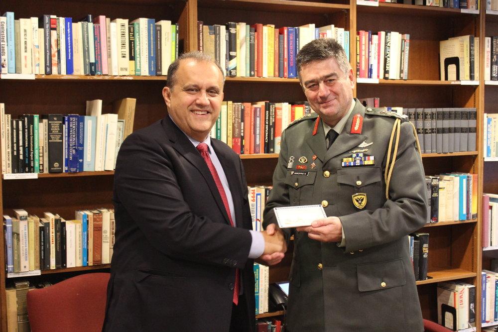Nick Larigakis presents Lt. General Manouris with a memento.