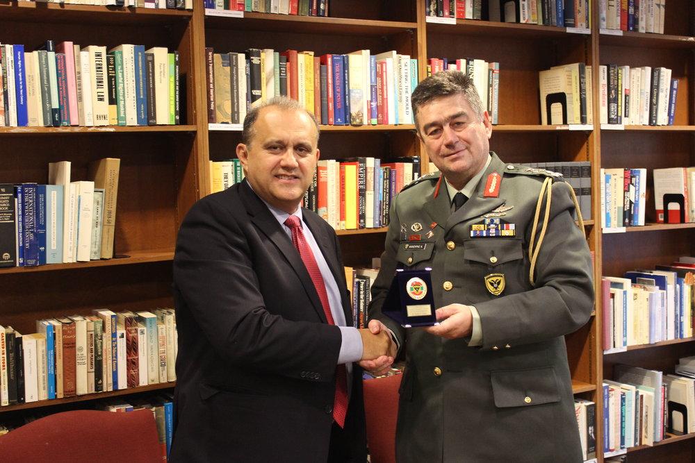 Lt. General Manouris presents Nick Larigakis with a memento.