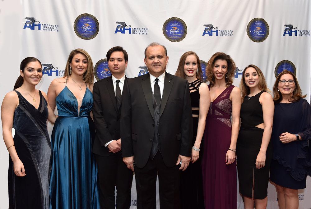 AHI President Nick Larigakis with AHI staff and volunteers