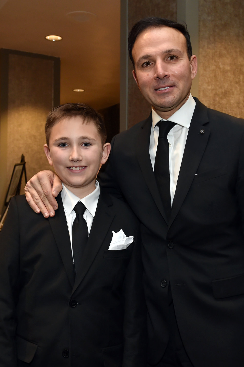 George Sifakis with his son