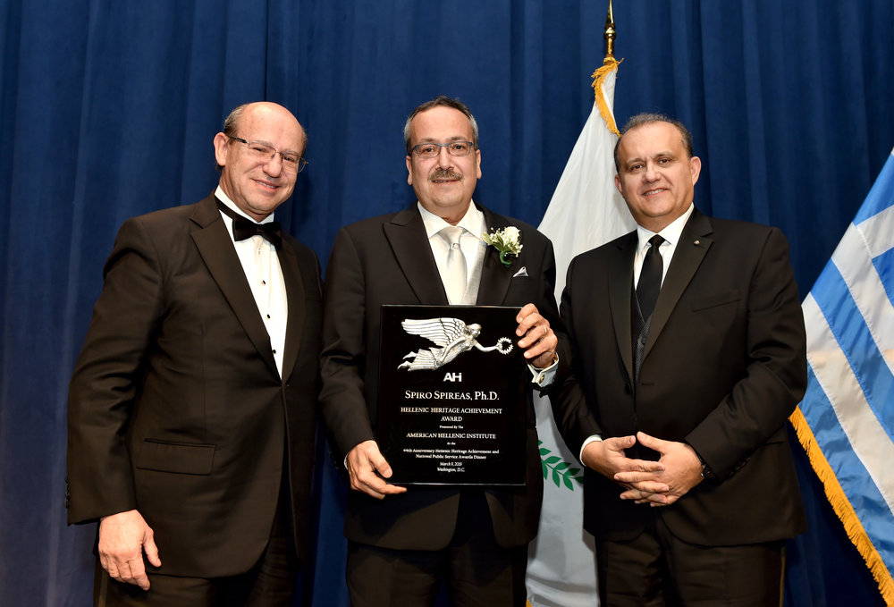Dr. Spiro Spireas receiving the award from Nick Larigakis and Costas Galanis