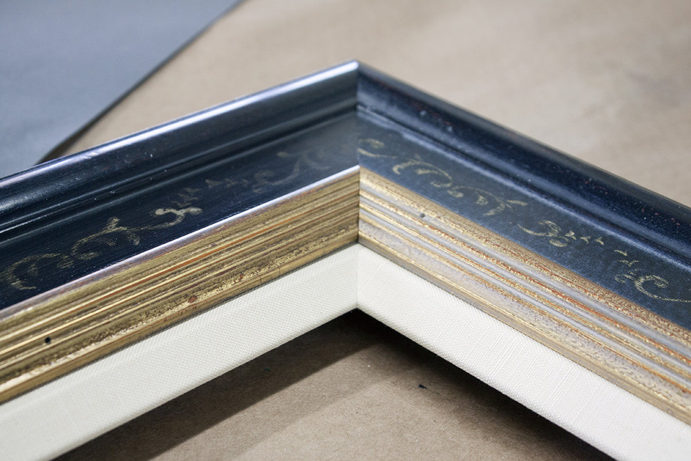 Frame Liner - A fabric-covered mini-frame that sits within the main moulding. Typically used on canvases or stiff panels. This upgrade creates a more luxe final product. Liners customarily come in linen, silk, and cotton.