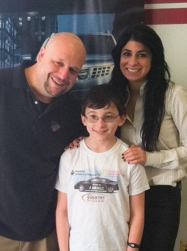 From left, Chris Kellogg, of 94.7 WMAS, Matthew Dion, of Springfield, a Childrenâs Miracle Network âMiracle Kid,â and Carla Cosenzi, president of Country Nissan, during the Hadley dealershipâs kickoff event on Feb. 11 to mark National Cancer Prevention Month.
