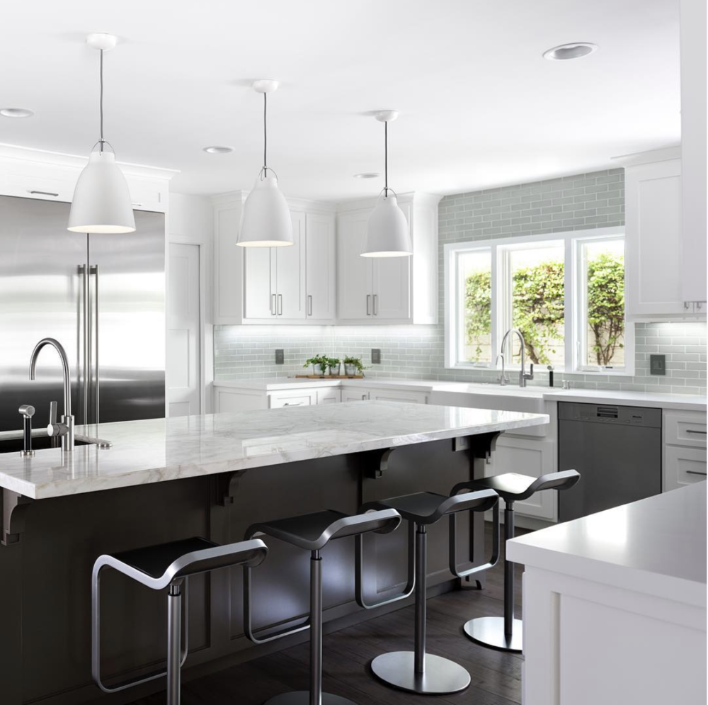A beautiful white kitchen designed by Los Angeles based Four Point Design Build