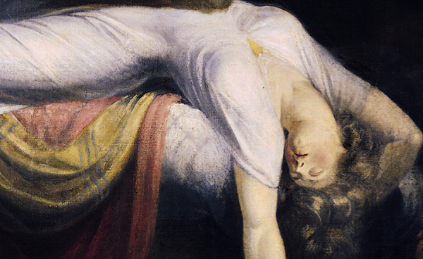 Her posture and white dress indicate her vulnerability.