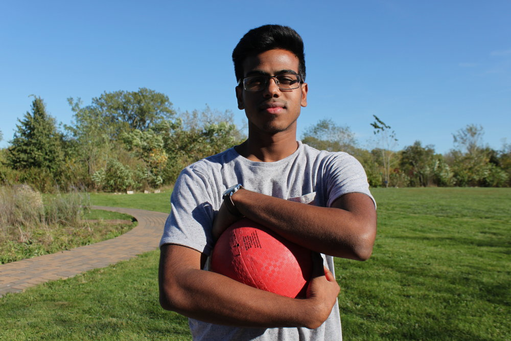 Jawad Moshin, Adv. 808,clutches the ball.