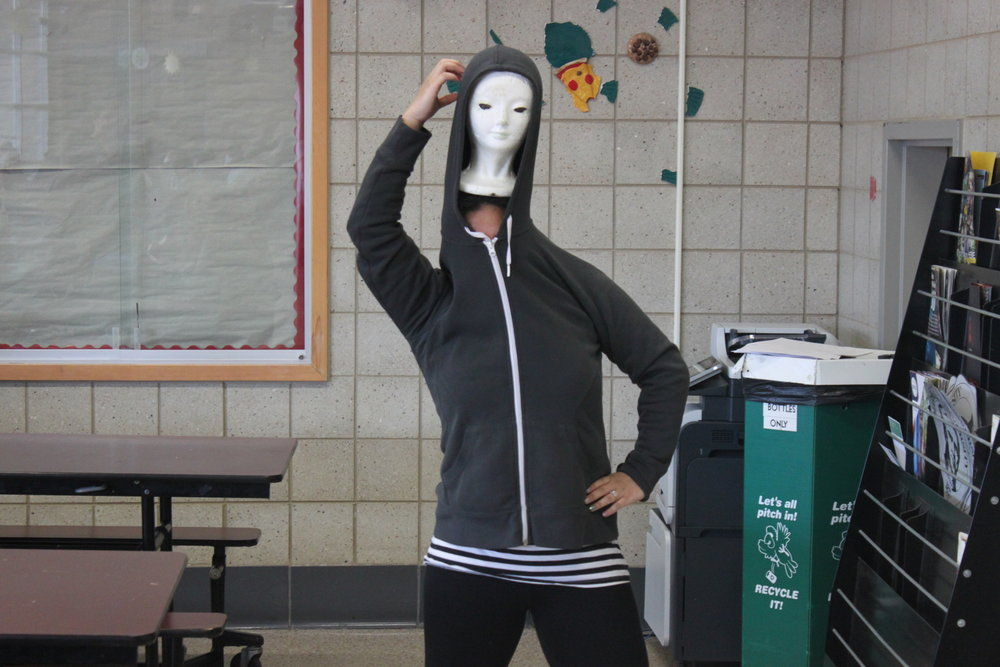 Engelica Santillian dances with a mannequin head under her sweatshirt just like the meme.