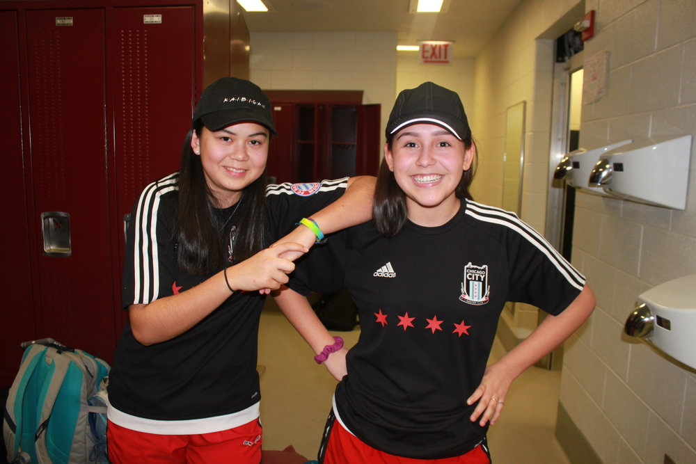 Audrey McManus and Gaby Jiminez wear matching soccer jerseys, shorts and hats as their twin day look.