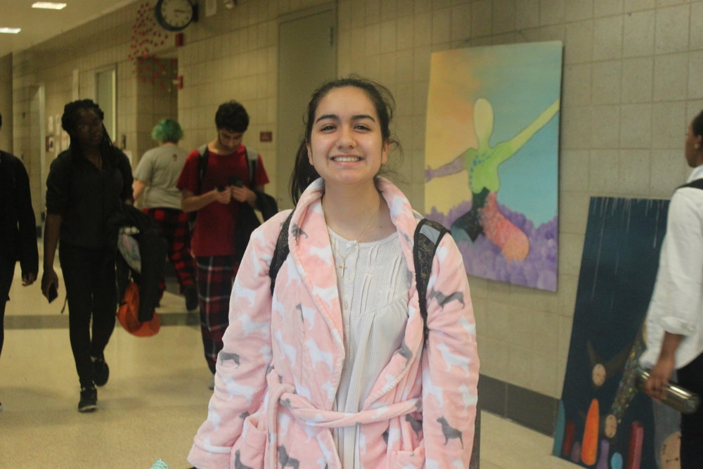 Alexis Martinez smiles in her fluffy robe.
