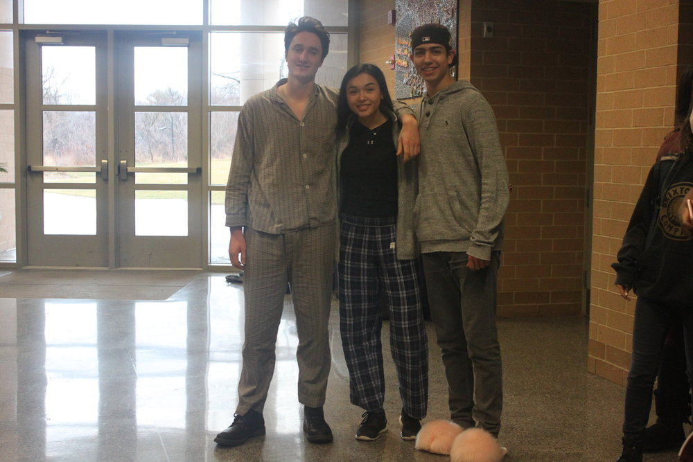Leon Sommer-Simpson, Kelsey Tsonton, and Benjamin Rosenguard pose in their pajamas.