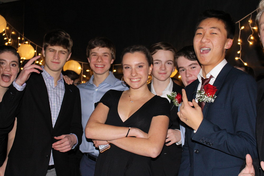 A group of junior boys joined by Faith Zehfuss and Erin Goldman are more than excited to take on Homecoming as they enter the dance floor.