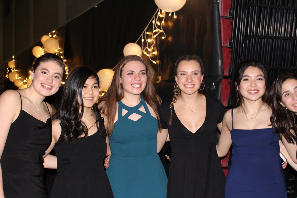 A group of Junior girls have a ball at Homecoming.