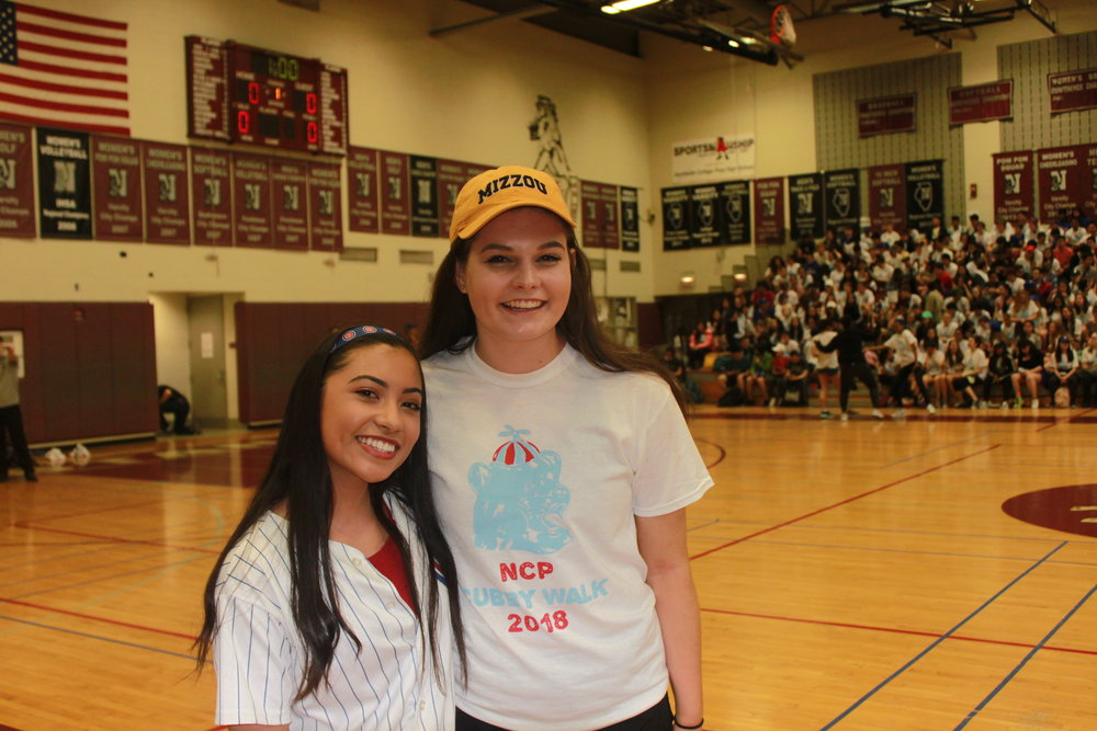 Eva Empelo and Kathryn Merck smile before they show the crowd their skills in the Home Run Derby.