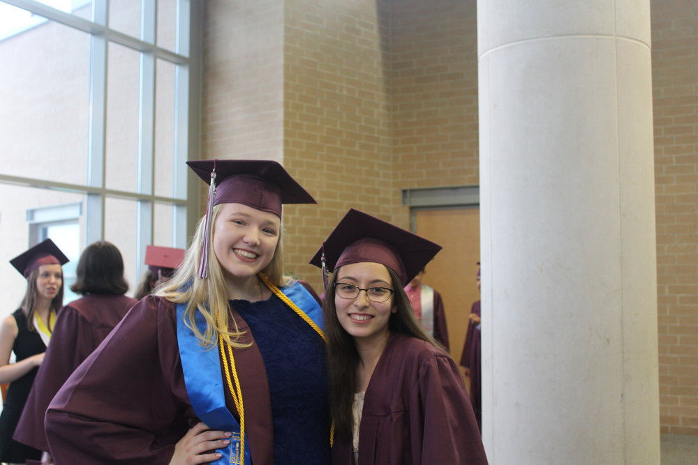 Happy to be graduating, Sarah Fitzmaurice, Adv. 805, and Stephanie Rodriguez, Adv. 807, flash big smiles for the camera