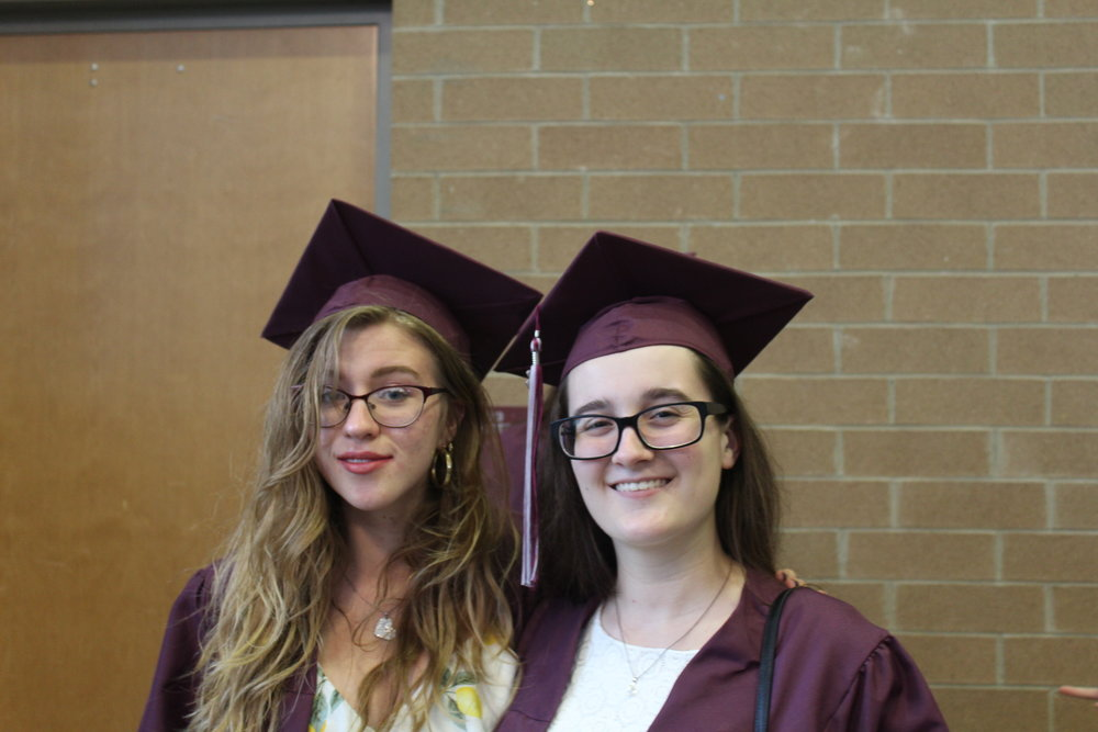 Proud of their accomplishments, Alexandra Barnes, Adv. 806, and Sarah Loos, Adv. 807, pose for the camera
