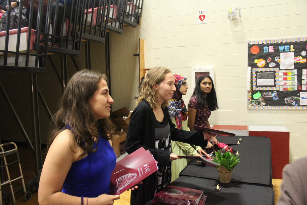 Dutifully handing out pamphlets, juniors in National Honor Society help graduation run smoothly