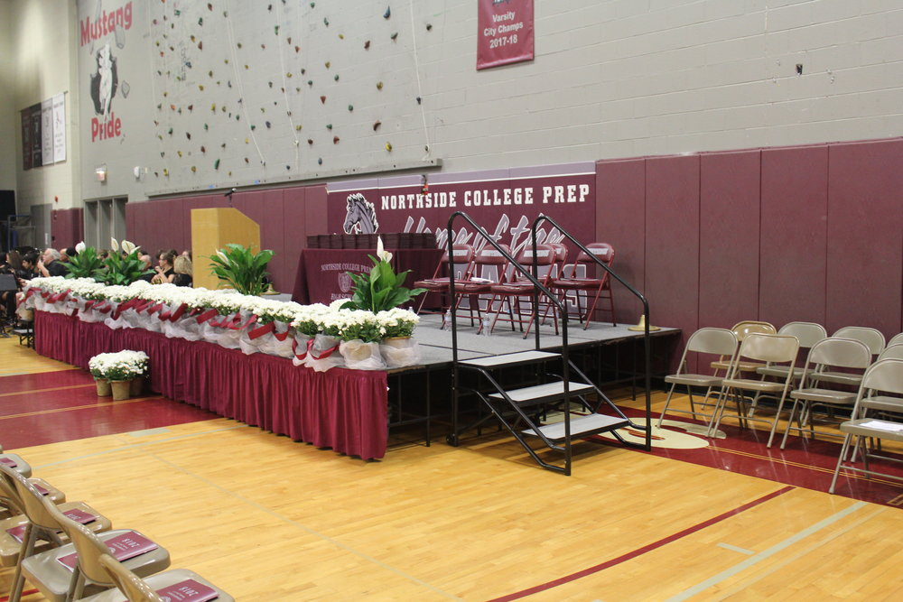All is calm and ready for the graduates as friends and family fill the gymnasium