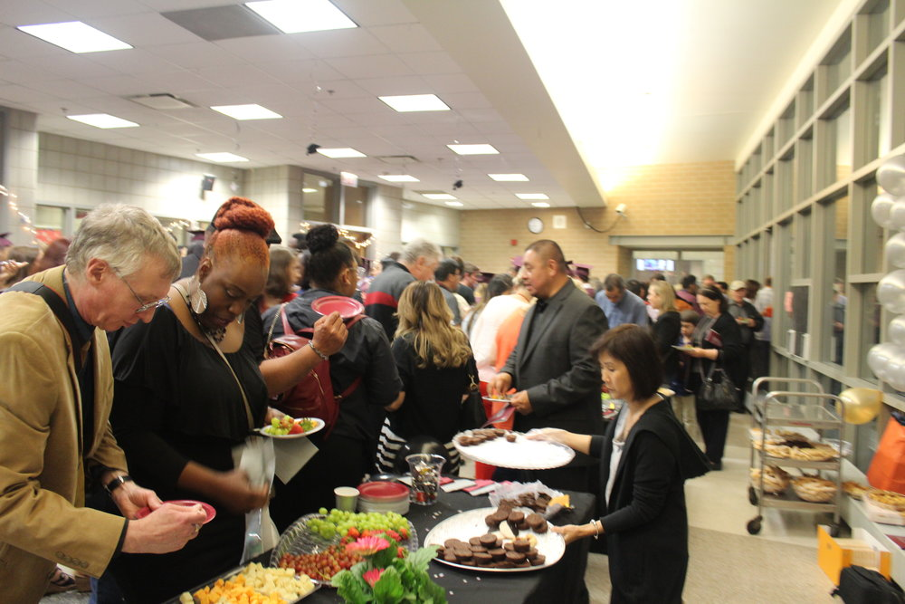 Post-ceremony, attendees enjoy complimentary snacks provided by Friends of Northside in the cafeteria
